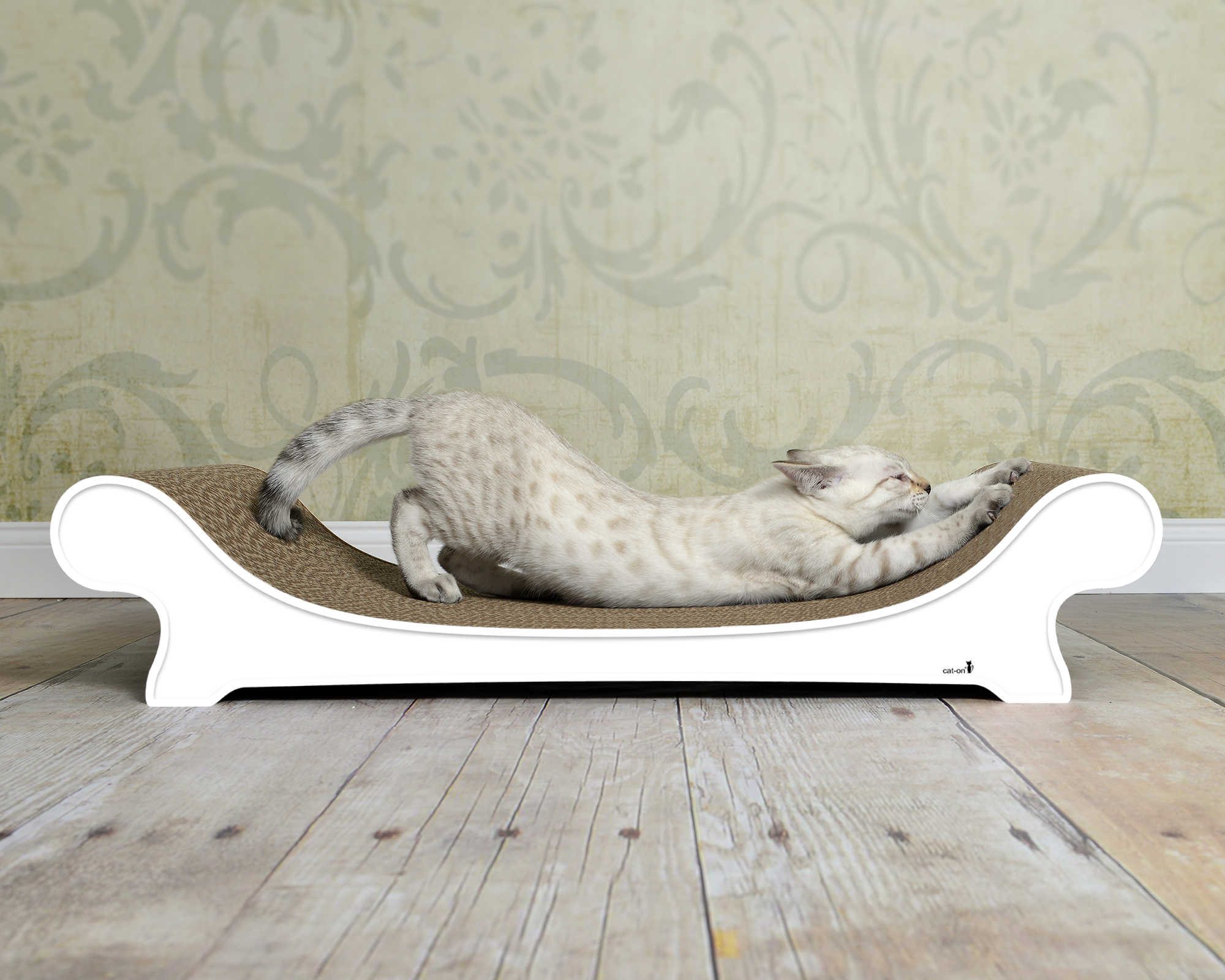 White cat sofa with scratching surface made of robust corrugated cardboard